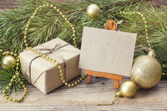 Miniature easel with blank card, gift box, pine branches and Chr Royalty Free Stock Photography