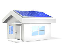 Miniature of an eco-house with solar cells. Royalty Free Stock Images