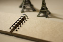 Miniature Eiffel towers and a sketch book Stock Photography