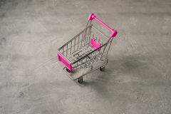 Miniature empty pink shopping trolley Stock Photography