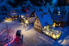 Miniature Europe village in winter. Miniature Europe village with antique houses covered by snow at night with light up decoration. Christmas winter season for stock image