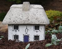 Miniature French fairy home. Miniature fairy home designed to resemble a French home found in the countyrside stock photography