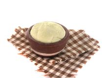 Miniature fake bowl with raw dough on checkered towel. Dollhouse stock photography