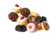 Photo Miniature fake cakes and donuts. Miniature fake cakes and donuts on white background. Dollhouse miniature, polymer clay toy, plastic dummies Royalty Free Stock Photo