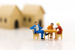 Miniature Families are celebrating , eating together happily. Used in the concept of family festival stock photo