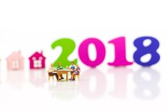 Miniature Families are celebrating the New Year in 2018, eating stock photo