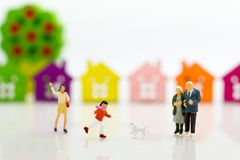 Miniature family: Boy is running with dog. Image use for Family day Royalty Free Stock Photography