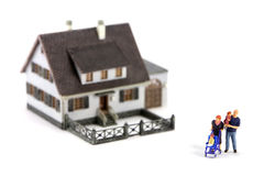 Miniature family and house Royalty Free Stock Images