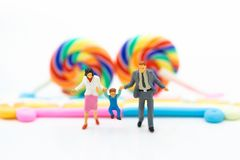 Miniature family. Image use for spending time with family.  stock photo