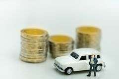 Miniature Figure : Business man is standing beside the white car stock photo