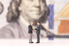Miniature figure people businessman handshacking Stock Photo
