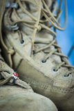 Miniature Figure Reading on Army Boots Royalty Free Stock Photo