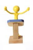 Miniature Figure on Rostrum Stock Images