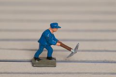Miniature Figure of a Single male Worker royalty free stock photo