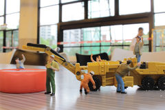 Miniature figure of technicians working Royalty Free Stock Photography