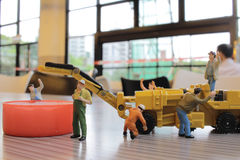 Miniature figure of technicians working Royalty Free Stock Photos