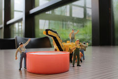 Miniature figure of technicians working Royalty Free Stock Image