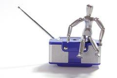 Miniature Figure and Transistor Radio Stock Photo