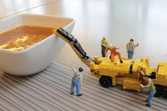 Miniature figure working on Bolognaise Royalty Free Stock Photos