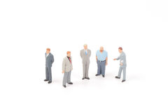 Miniature figures of business man. On  back ground Stock Photos