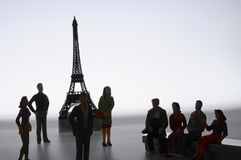 Miniature figures in front of Eiffel tower Royalty Free Stock Images