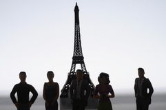 Miniature figures in front of Eiffel tower Royalty Free Stock Photo