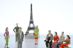 Miniature figures in front of Eiffel tower Royalty Free Stock Image