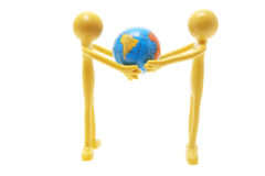 Miniature Figures and Globe Stock Photo