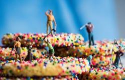 Miniature Figures Golfing On Sprinkle Cookies Stock Photo