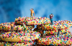 Miniature Figures Golfing on Sprinkle Cookies Royalty Free Stock Photo