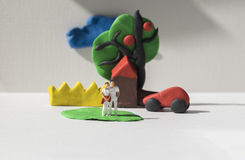 Miniature figures in group, conceptual Stock Photography