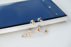 Miniature figures in group, conceptual Stock Image