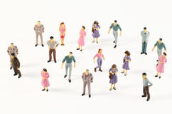 Miniature figures of human in costumes Stock Photo