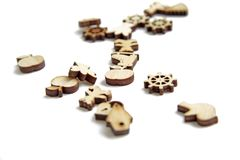 Miniature figures laser cutting wood royalty free stock photos