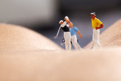 Miniature Figures playing golf Royalty Free Stock Photography