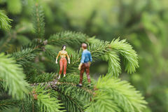 Miniature figures on the tree Stock Photography