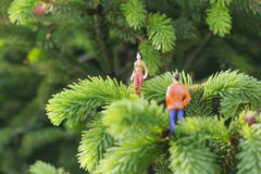 Miniature figures on the tree Royalty Free Stock Photo