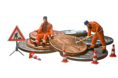 Miniature figures working on a heap of Dollar coin Royalty Free Stock Image