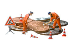 Miniature figures working on a heap of Dollar coin Royalty Free Stock Images