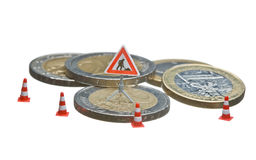 Miniature figures working on a heap of Euro coins. Royalty Free Stock Photography