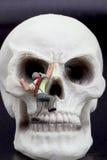 Miniature figurine of a climber on a skull Stock Photo