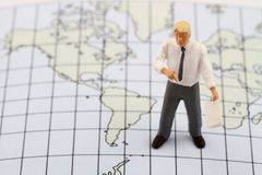 Miniature figurine of a geography teacher Stock Images