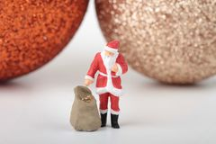 Miniature figurine of Santa Claus with gifts bag stock image
