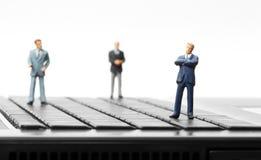 Miniature figurines of businessman Royalty Free Stock Photos