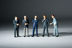 Miniature figurines of successful business team. Five statuettes Stock Photography
