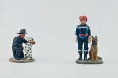 Miniature of firemen and their dogs stock photos
