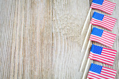 Miniature flags on wooden board with copy space Stock Images