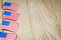 Miniature flags on wooden board Stock Image