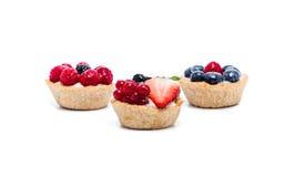Miniature forest fruit desserts. Delicious miniature forest fruit desserts Royalty Free Stock Photography