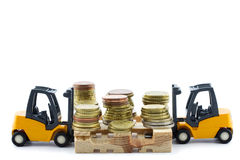 Miniature forklift trucks lifting euro coins Royalty Free Stock Image